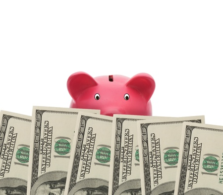 A border of American money and a piggy bank isolated on white with copy space, Watching your money photo