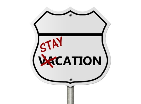 staycation: An American interstate road sign with words stay-cation isolated over white, Taking a stay-cation Stock Photo