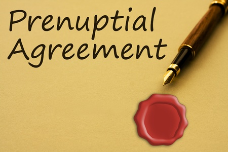 A fountain pen with yellow paper with a wax seal and words prenuptial agreement and copy-space, Getting a prenuptial agreement Stok Fotoğraf