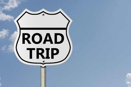 An American interstate road sign with words Road Trip with sky background, Taking a Road Trip Stock fotó