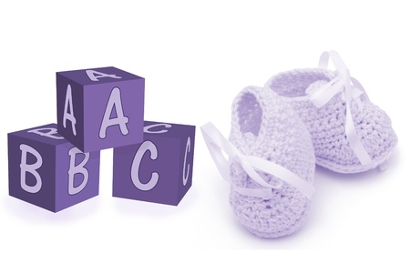 Purple crochet baby booties with ABC blocks isolated on white, Hand-made baby booties