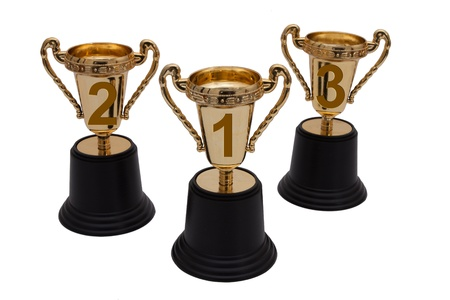 Three gold trophies isolated on white, First, Second and Third Place