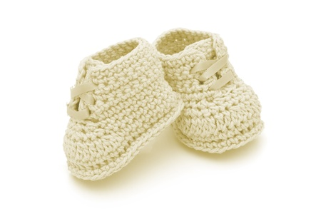 Yellow crochet baby booties isolated on white, Hand-made baby booties Фото со стока - 13441499