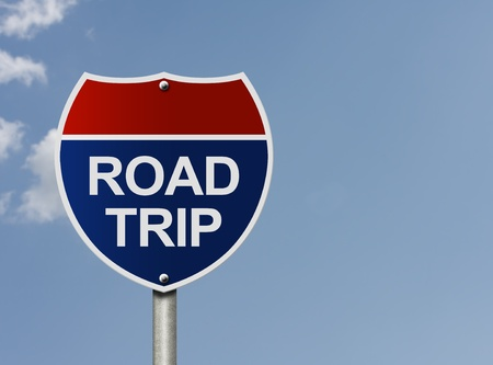 staycation: An American interstate road sign with words Road Trip over a sky background, Taking a road trip