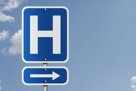 sign h: An American road sign with a sky background and a capital H, Hospital Direction Sign