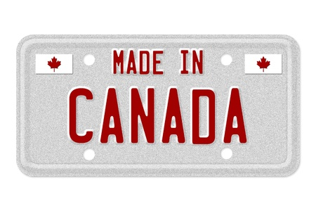The words Made in Canada in red on license plate isolated on white, Made in Canada License Plate photo