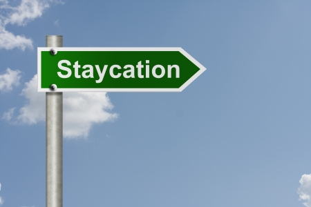 staycation: An American road sign with sky background and copy space for your message, Taking a staycation