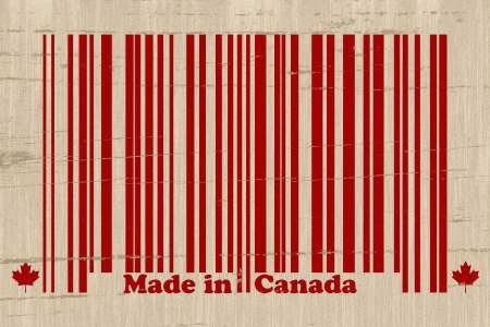 A red bar code with the words made in Canada on a grunge background, Make in Canada