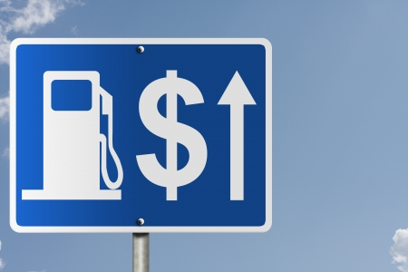 An American road sign with a sky background gas symbol, arrow and dollar sign, The price of gas increasing photo