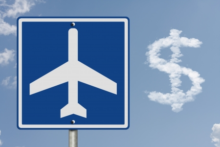 An American road sign with a sky background and airplane symbol and cloud in shape of a dollar sign, Cost of airline tickets photo