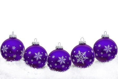 Purple Christmas ornaments with snowflakes and snow  isolated on white, Christmas Time