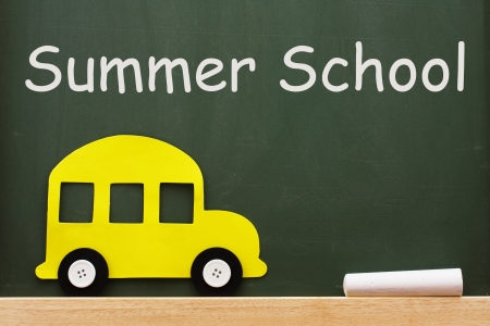Chalkboard words Summer School and yellow bus and chalk, Summer School