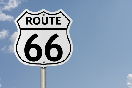 An American interstate road sign with numbers 66 with sky background, Taking route 66