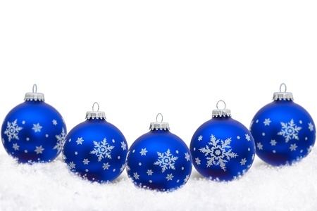 blue christmas ornaments with snowflakes and snow isolated on white christmas time stock photo