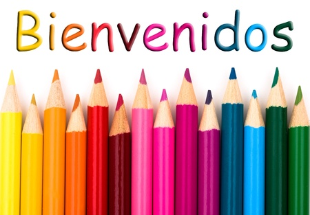 A pencil crayon border isolated on white background with words Bienvenidos, Spanish welcome Stock fotó