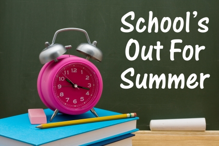 out time: Book with pencil and eraser with a retro alarm clock  in front of a chalkboard, Schools out of Summer