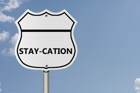 staycation: An American interstate road sign with word stay-cation with sky background, Taking a stay-cation