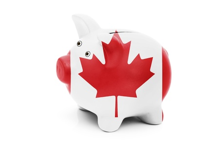 canadian coin: Piggy bank in the Canadian flag colors isolated on white, Money management for Canadians