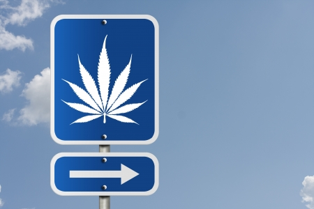 An American road sign with a sky background and marijuana leaf and arrow, Marijuana this way photo