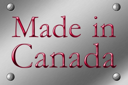 Brushed Steel Plate with screws in corner and the words made in Canada in red Stock Photo