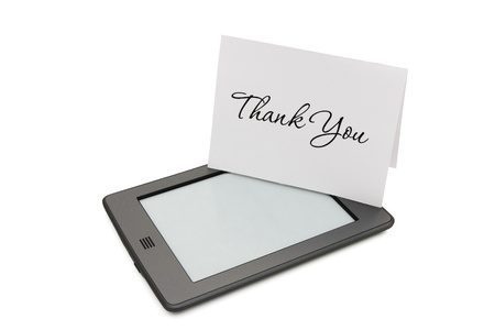 ereader: A touch e-reader with thank you card isolated on white