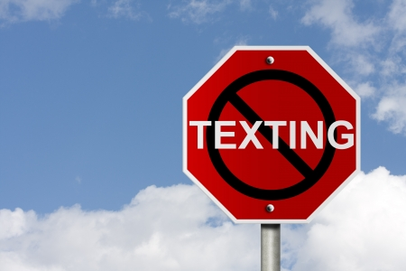 texting: An American road sign with sky background and copy space for your message, Stop texting and driving