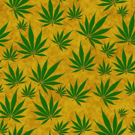 A bunch of  marijuana leaves on a golden  background that is seamless photo