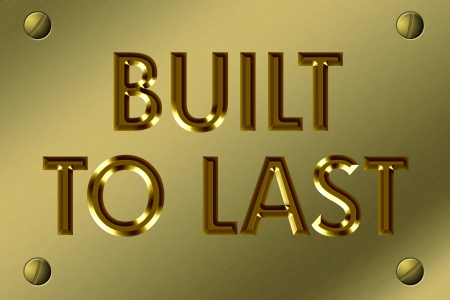 The words Built to Last in gold on a metal sign 版權商用圖片