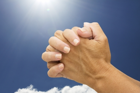 hands praying: Female hands praying with a sky background, Praying Hands