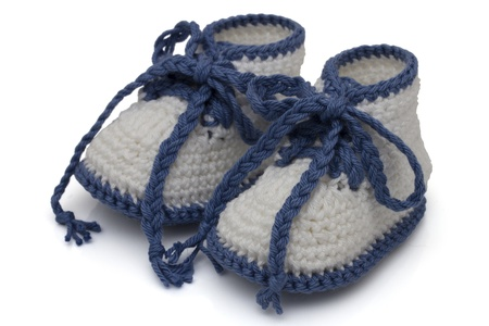 Blue and White crochet baby booties isolated on white, Hand-made baby booties