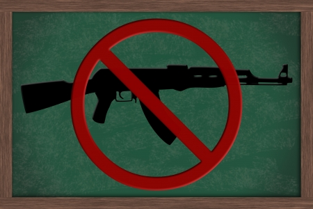 Chalkboard with a rifle and a Not Allowed Symbol, No Guns Allowed in Schools photo