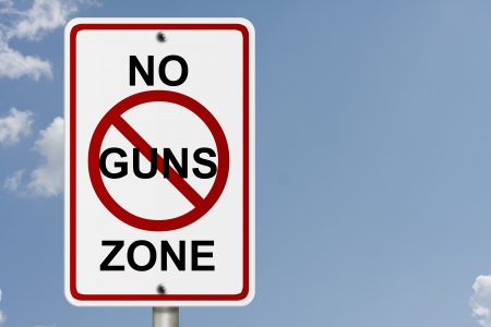An American road sign with sky background and copy space for your message, No Guns Zone photo