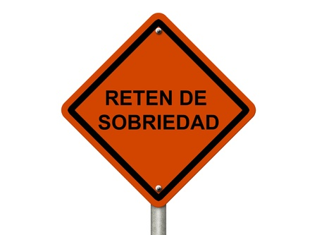 impaired: An American road warning sign isolated on white with words Reten De Sobriedad in spanish checkpoint, Stop Drinking and Driving
