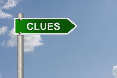 clues: An American road sign with a sky background and word clues, Clues this way Stock Photo