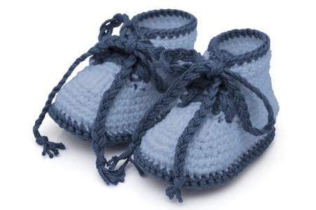 Blue crochet baby booties isolated on white, Hand-made baby booties photo