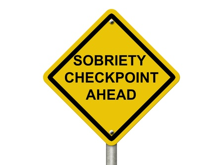 An American road warning sign isolated on white with words Sobriety Checkpoint Ahead checkpoint, Stop Drinking and Driving photo