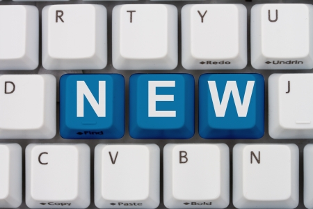 inform information: Computer keyboard keys with word New, New offerings Stock Photo