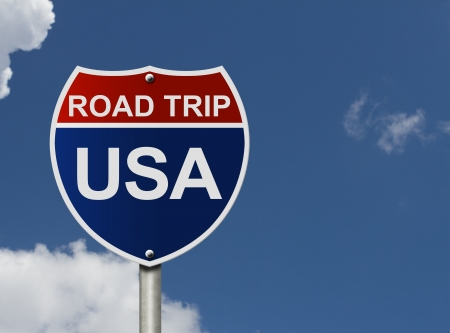 An American road interstate sign with words Road Trip USA with sky, Road Trip USA Zdjęcie Seryjne