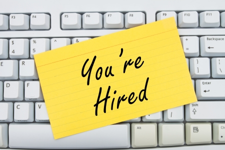 Computer keyboard keys with index card with words You're Hired, You are Hired Stock Photo - 20422663