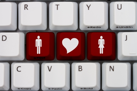 website words: Computer keyboard keys with symbols of man and woman and a heart, Internet Dating