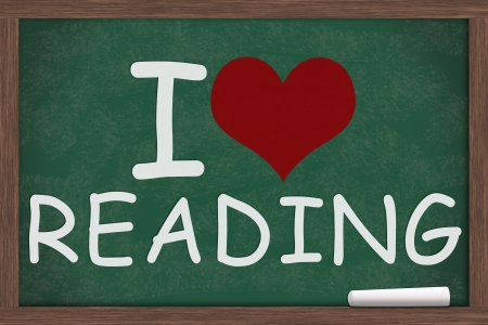 i like my school: I heart, love reading written on a chalkboard, I love reading Stock Photo