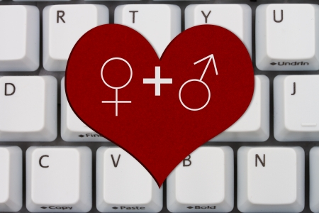 Computer keyboard keys with symbols of man and woman on a heart, Internet Dating photo
