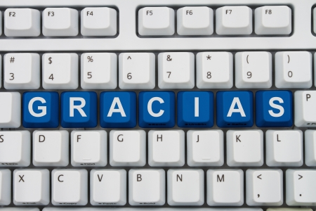 Computer keyboard keys with word Gracias, Spanish thank you, Gracias for your online purchases Stock Photo - 20747877