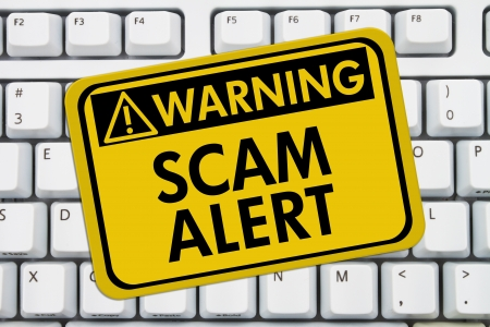 web scam: Computer keyboard keys with warning sign with words Scam Alert, Scam Alert Stock Photo