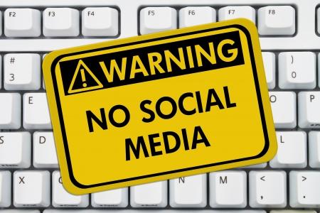 Computer keyboard keys with warning sign with words No Social Media, No accessing social media at work Stock Photo