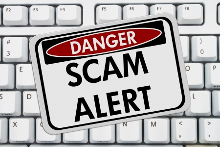 web scam: Computer keyboard keys with danger sign with words Scam Alert, Scam Alert Stock Photo