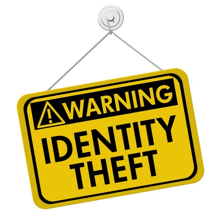 theft prevention: A yellow and black sign with the words Identity Theft isolated on a white background, Warning of Identity Theft Stock Photo