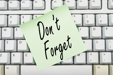 Computer keyboard keys with sticky note with words Don't Forget, Reminder of what to do Stock Photo - 21128661