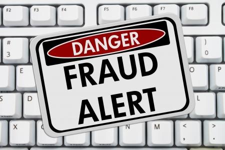 web scam: Computer keyboard keys with danger sign with words Fraud Alert, Fraud Alert