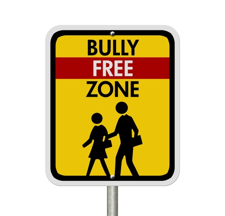 intimidating: An American road warning sign isolated on white with children walking symbol and words Bully Free Zone, Caution This is a Bully Free Zone Stock Photo